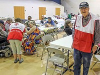 POSTCARDS: AT 87, 'DISASTER DEACON' OPENS HIS HEART - AND CHURCH - TO FLOODING VICTIMS