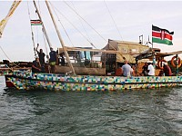 WOW!: BOAT MADE OF FLIP-FLOPS FLIES FLAG FOR CLEANER AFRICAN SEAS