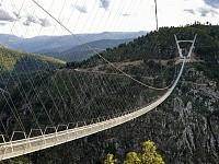 StrangeSights: Belgium farmer moves national border; the world's longest pedestrian suspension bridge; and, 'Galaxy Quest' at the US Congress...