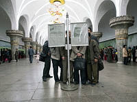 Snapshot: Reading a newspaper, Pyongyang, North Korea