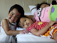 LIFESTORY: AGED FOUR AND SCARRED FOR LIFE - THE CHILDREN WHO SURVIVED AN INDONESIAN CHURCH ATTACK